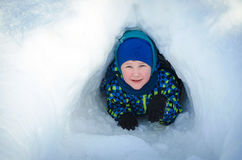A child comes out of the snow cave Stock Image