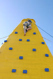 Child coming down from a climbing wall Royalty Free Stock Photo