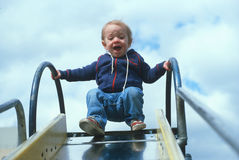 A child coming down a slide Royalty Free Stock Photography