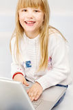 Child and computer Royalty Free Stock Image