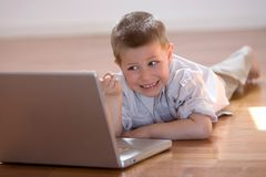 Child with computer. Child having fun with a computer at home Stock Photo