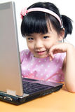 Child with computer. Little child girl is using laptop computer Stock Image