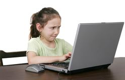 Child on computer. One young child working on a computer over white Stock Photography