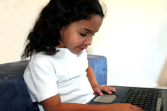 Child on Computer. Child in a school library Royalty Free Stock Image