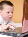 Child with computer Stock Photography