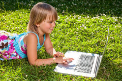 Child with computer outdoor Stock Photography