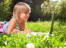 Child with computer outdoor Stock Image