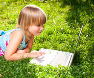 Child with computer outdoor Royalty Free Stock Images
