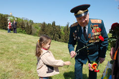 Child congratulates veteran. Stock Photo