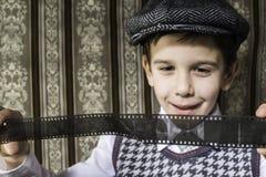 Child considered analog photographic film Royalty Free Stock Photo