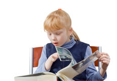 Child considers the book Royalty Free Stock Image