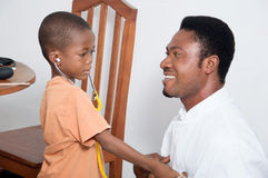 Child consolation. The doctor is consulting with the child so that he is not scared by this unit Royalty Free Stock Image
