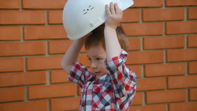 A child in a construction helmet stock footage