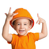 Child in the construction helmet. Royalty Free Stock Photo