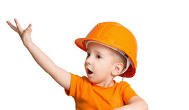 Child in the construction helmet. Royalty Free Stock Images