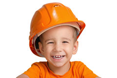 Child in the construction helmet. Stock Images