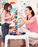 Child with  construction set in play room. Royalty Free Stock Image