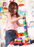 Child with  construction set in play room. Royalty Free Stock Images
