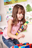 Child with  construction set playing. Royalty Free Stock Photo