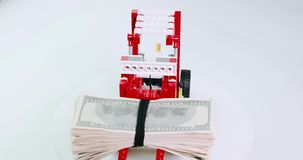Child constructor forklift keeps a pile of money and turns.  stock video