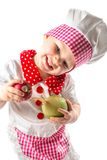 Child cook girl wearing chef hat with fresh vegetables Royalty Free Stock Photo