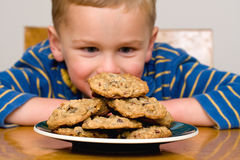 Child with cookies royalty free stock image