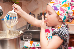 Child cooking at home. Sweet pie, mixes ingredients Stock Image