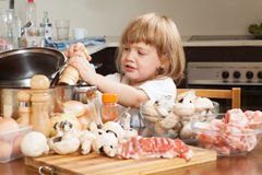 Child cooking in kitchen Royalty Free Stock Photos