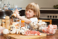Child cooking in kitchen Stock Photography