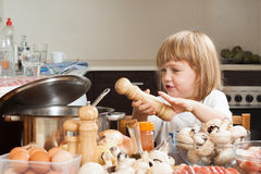 Child cooking in kitchen Stock Photos
