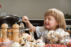 Child cooking in kitchen Stock Photo