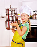 Child cooking at kitchen. Royalty Free Stock Photo