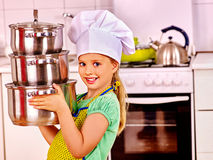 Child cooking at kitchen Stock Images