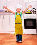 Child cooking at kitchen Royalty Free Stock Photo