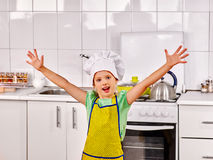 Child cooking at kitchen Royalty Free Stock Image