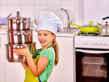 Child cooking at kitchen Stock Photos