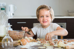 Child cooking meat dumplings Stock Photos