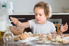Child cooking meat dumplings Royalty Free Stock Photos