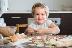 Child cooking meat dumplings Stock Photo