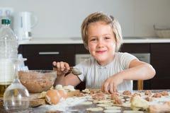 Child cooking meat dumplings Stock Image