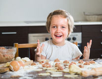 Child cooking meat dumplings Royalty Free Stock Images