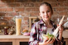 Child cooking skills girl prepared salad dinner. Child cooking skills. little girl prepared salad for dinner. culinary education and family lifestyle royalty free stock photo