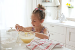 Child cooking Stock Images