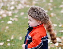 Child with coonskin cap. Young male child in a coonskin cap Royalty Free Stock Photography