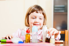 Child with cosmetic products Stock Images