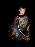 Child in a costume. Little boy in a dark knight costume with a shield Royalty Free Stock Photos