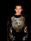 Child in a costume. Child in his Halloween costume with a grin on his face royalty free stock image