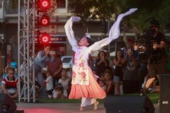 Young girl performs Chinese sleeve dance on stage royalty free stock image