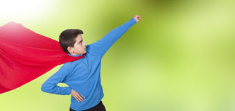 Child with costume superhero. In an attitude of strength Stock Photography