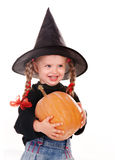 Child in costume witch with pumpkin. Royalty Free Stock Photography